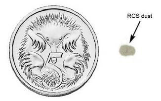 "This image shows a round coin with a much smaller indistinct grey shape next to it, for size comparison, with an arrow and the words ""RCS dust"" labelling the grey shape."
