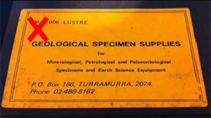 "This image shows a card or label with the words ""Geological specimen supplies"" printed on it."